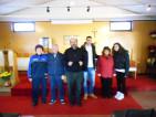 Don Carmine coi volontari della chiesa